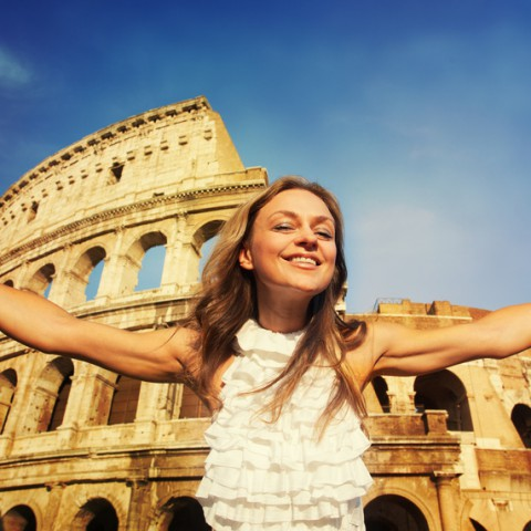 Rome, Italy. Woman on the background of the Colosseum. Happy tourist